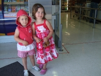 Poppy & Phoebe helping shop for our food list at the grocery store the day before we leave