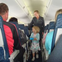 Handing out lollies in the plane on the way back to Nelson