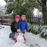 Adrienne & Poppy with the snowman