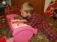 Putting Honey to bed in a new cot from Santa