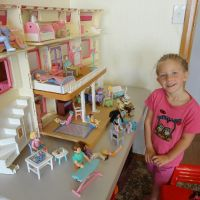 Playing with dolls house