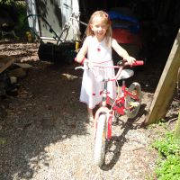 Mummy provides a farm bike to practice riding