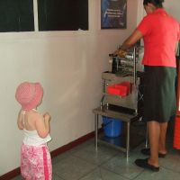 Watching the sugarcane juicer