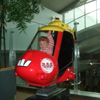 Playing on the helicopter at Auckland airport