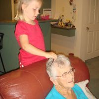 Doing Ma\'s hair - she loves this!