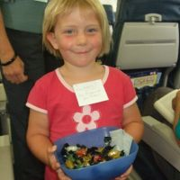 Handing out lollies on the plane