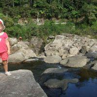 Climbing the rocks at McLaren Falls