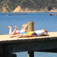 Poppy & Azzan waiting on the jetty