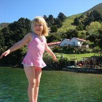 Poppy on the jetty with the Shand homestead in the background
