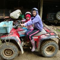 Poppy & Mahalia on the bike