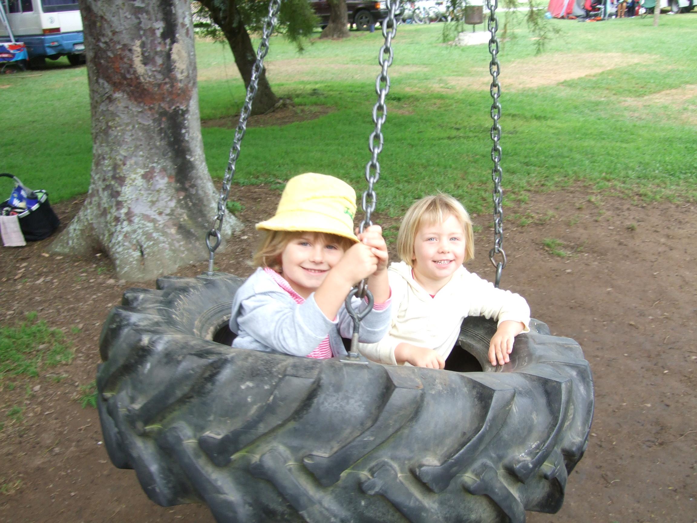 Charlee & Poppy on the tyre swing