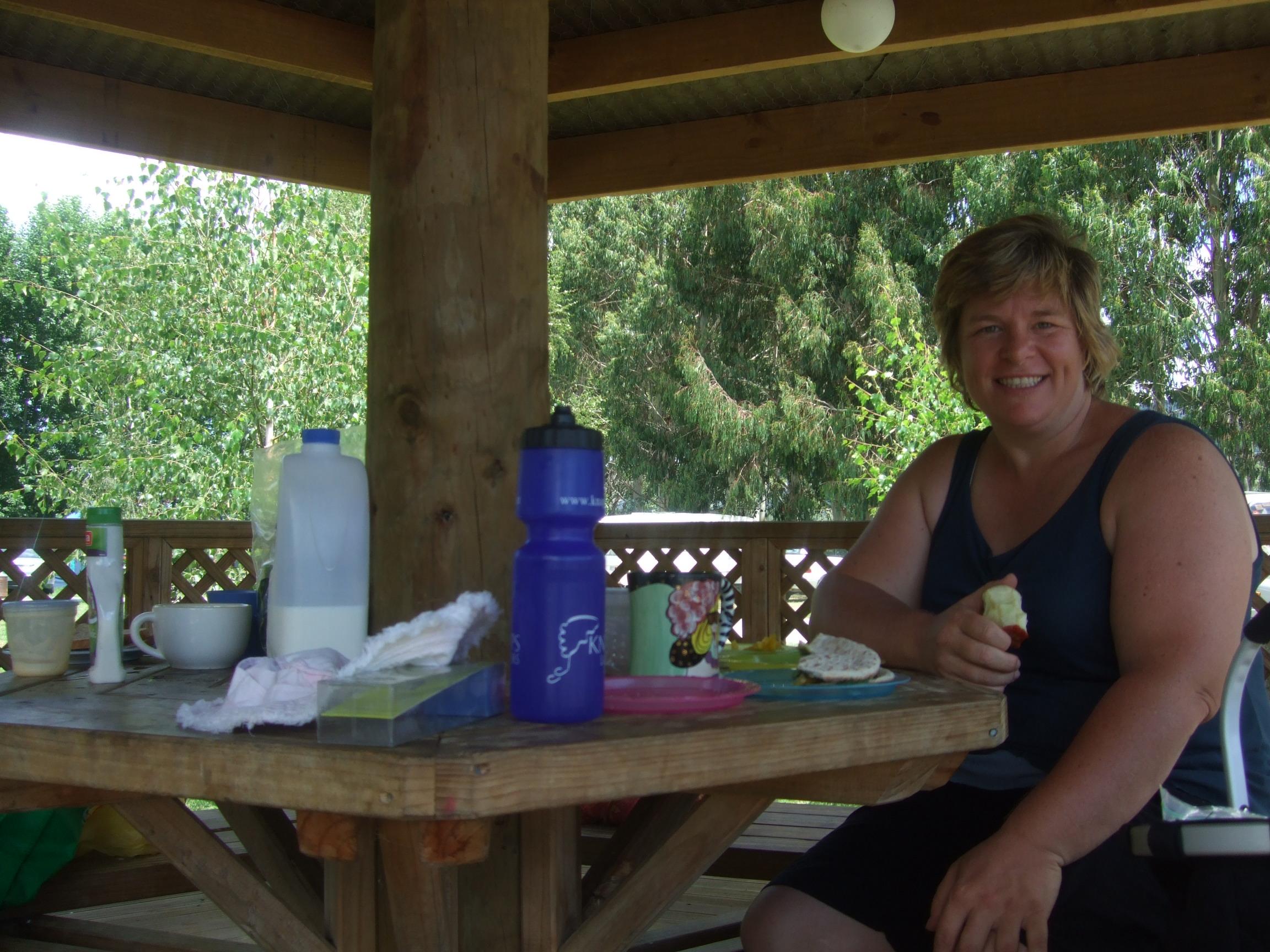 Adrienne eating lunch in the gazebo