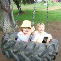 Charlee & Poppy on the tyre swing