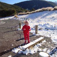 Poppy making snowballs
